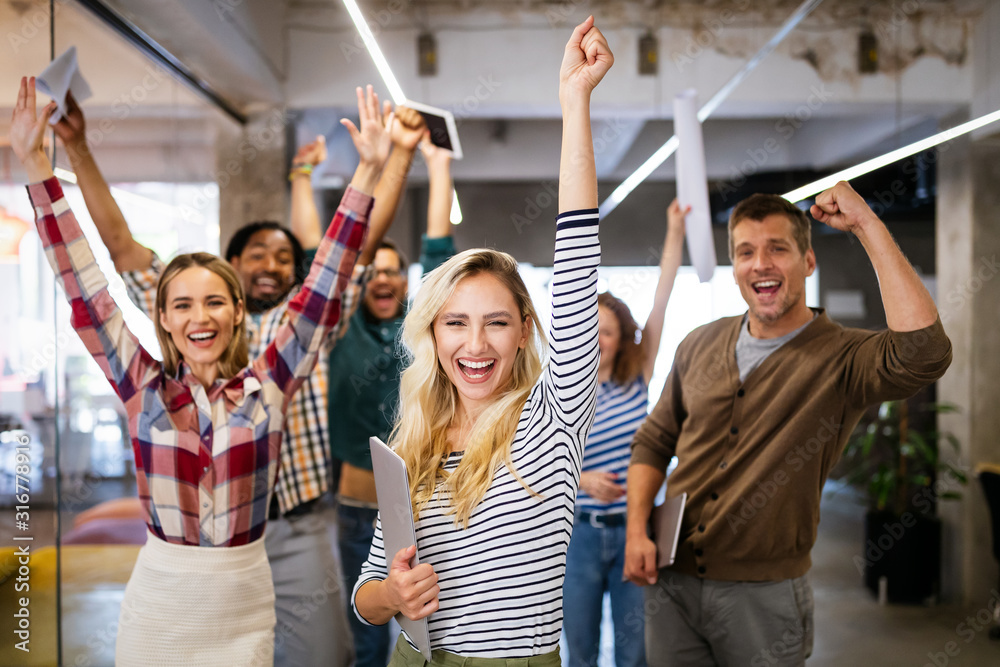Fototapeta Happy business people celebrating success at company