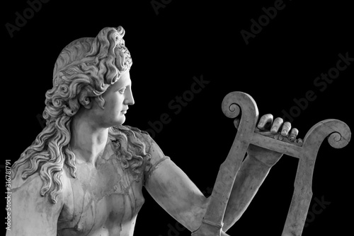 Vászonkép Ancient roman statue of God Apollo playing a lire - black and white photo