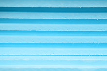 Background Soft Sheets Of Foam Insulation Lie On Each Other With Lines Of Different Shades Of Blue