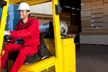 Warehouse Worker Using Forklift Truck