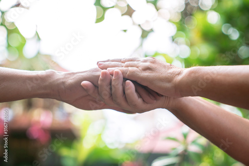Encouragement, Men and women shake hands to look after and help each other on the bokeh background Canvas Print