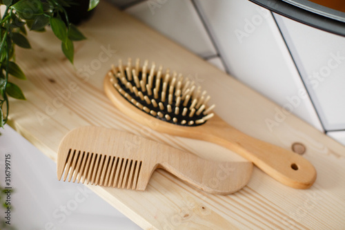 Photographie Spa and bath cosmetics, basket with towel rolls in rustic interior