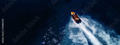 Fotografía Aerial drone ultra wide photo of jet ski couple cruising in high speed in tropic