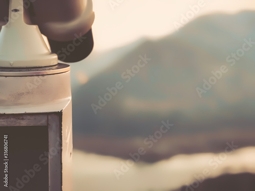 Fotomural  Paid outdoor tourist telescope against the backdrop of extending mountains and a