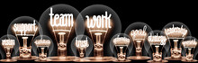 Light Bulbs With Team Work Con...