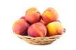 Leinwanddruck Bild Fresh peaches in basket isolated on white background