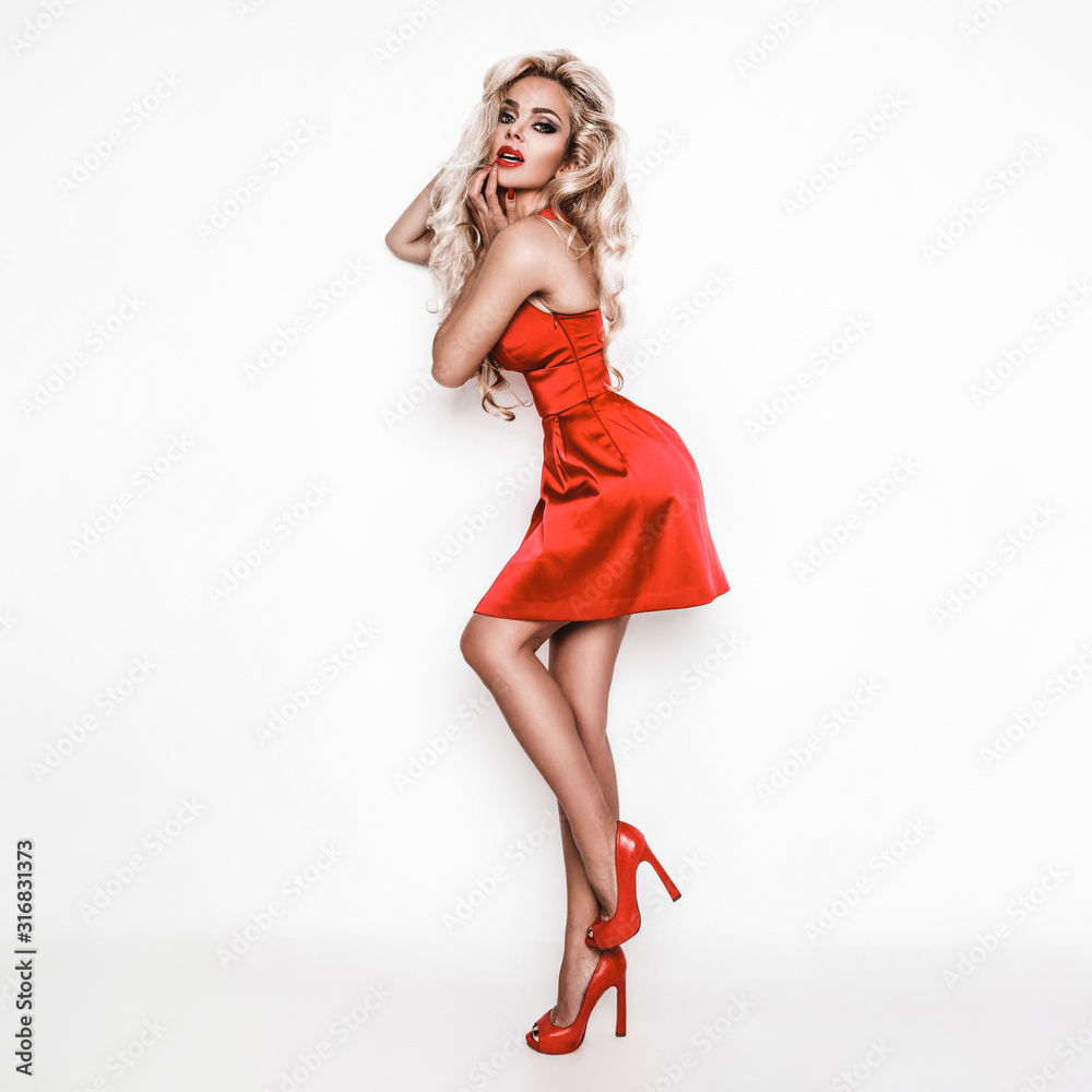Fototapeta Valentine beautiful girl in red dress isolated on white background. Beautiful Happy Young Woman on Valentine's Day. Christmas party, birthday. Joyful model - Photo