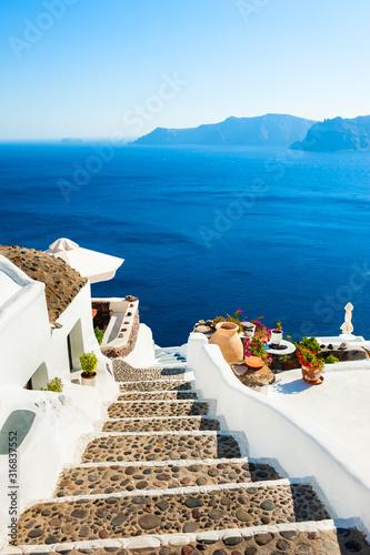 Fototapeta White architecture and blue sea on Santorini island, Greece. Stairs to the sea. Summer holidays, travel destinations concept obraz
