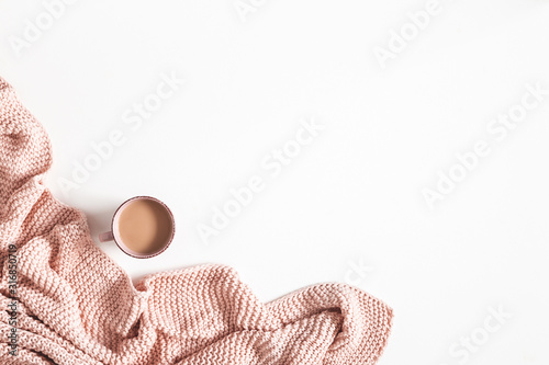 Photo Cup of coffee, pink blanket on white background
