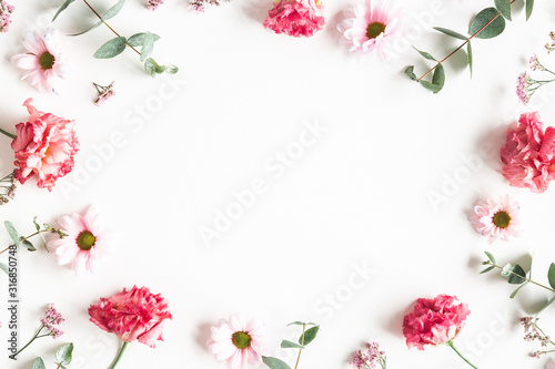 Obraz Flowers composition. Frame made of pink flowers and eucalyptus branches on white background. Valentines day, mothers day, womens day concept. Flat lay, top view - fototapety do salonu