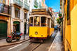 canvas print picture - Yellow vintage tram on the street in Lisbon, Portugal. Famous travel destination