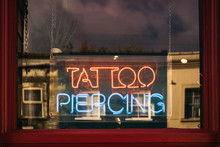 Neon Sign In The Window Of A T...