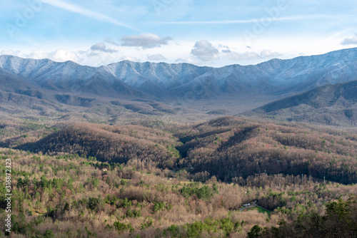 View of valley with snow capped mountain peaks