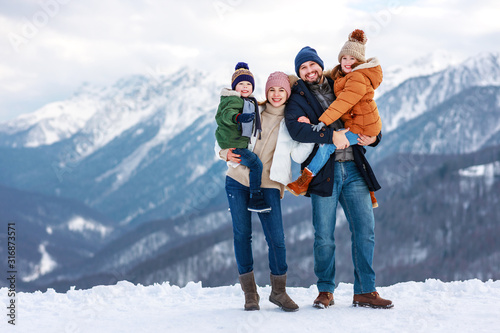 happy family mother father and children on winter nature  .