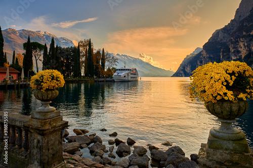 Canvas Print Beautiful and colorful autumn in Riva del Garda, Garda lake surrounded by mounta