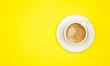 canvas print picture - Top view image of coffe cup on yellow background. Flat lay. Copy space