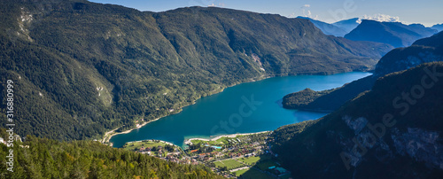 Aerial view over the beautiful Molveno town and Molveno lake, an alpine lake in Canvas Print