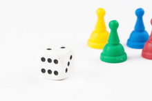 Colorful Figures And Dices Of Ludo Family Board Game Isolated On White Background. Copy Space.