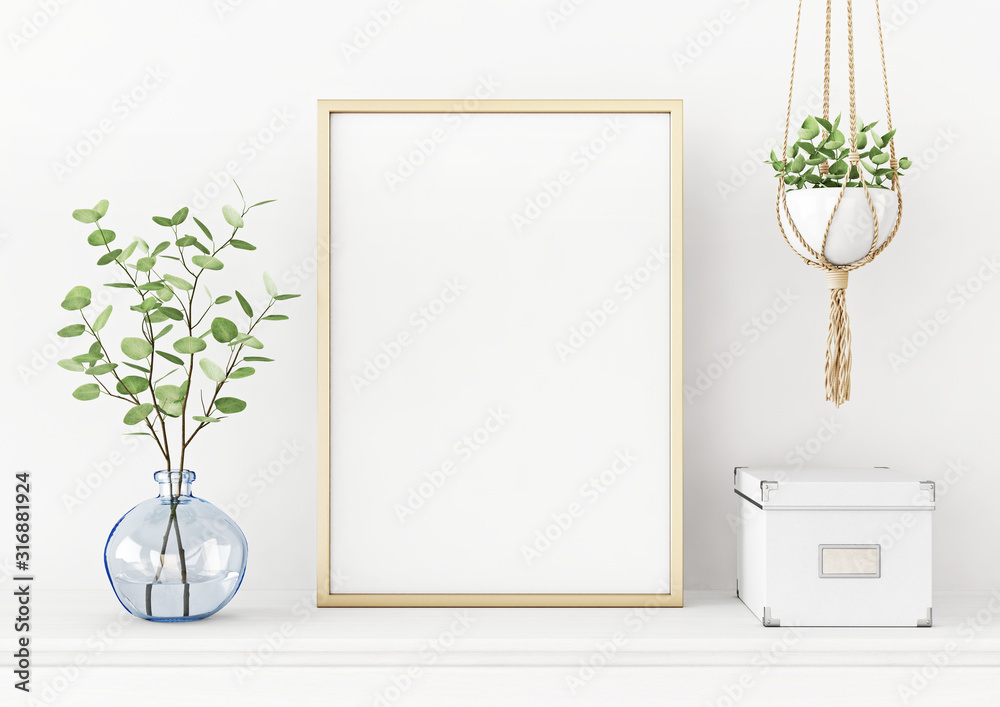 Fototapeta Interior poster mockup with vertical gold metal frame on the table with plants in blue vase and hanging macrame pot on empty white wall background. A4, A3 size format. 3D rendering, illustration.
