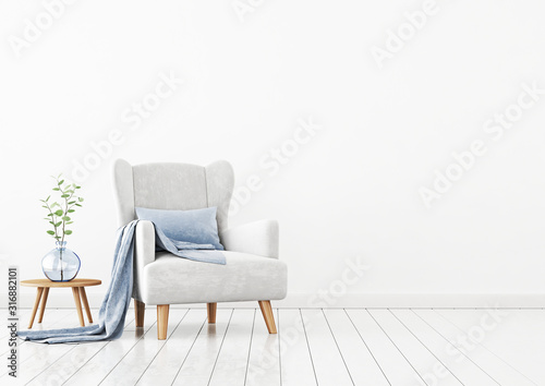Fotografía Living room interior wall mockup with light gray velvet armchair, blue pillow, plaid, coffee table and green plant branch in vase on empty white wall background