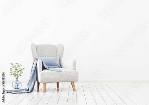 Fototapeta Living room interior wall mockup with gray velvet armchair, blue pillow, plaid and green plant branches in vase on empty white wall background. 3D rendering, illustration. obraz na płótnie