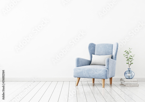 Fototapeta Living room interior wall mockup with blue velvet armchair, white pillow, pile of books and green plant branches in vase on empty white wall background