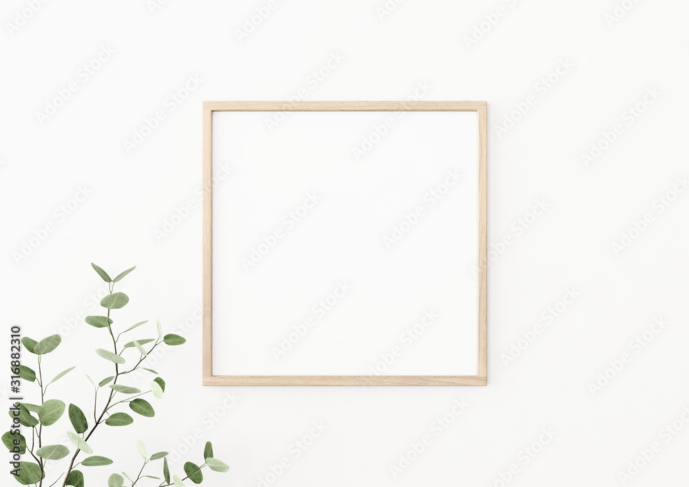 Fototapeta Interior poster mockup with square wooden frame on empty white wall decorated with plant branch with green leaves. 3D rendering, illustration.