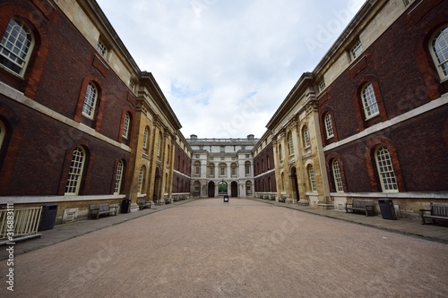 Big colorful building with large windows under a cloudy sky in Greenwich in Lond Fotobehang