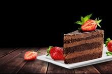 Slice Of Delicious Chocolate Cake On Desk