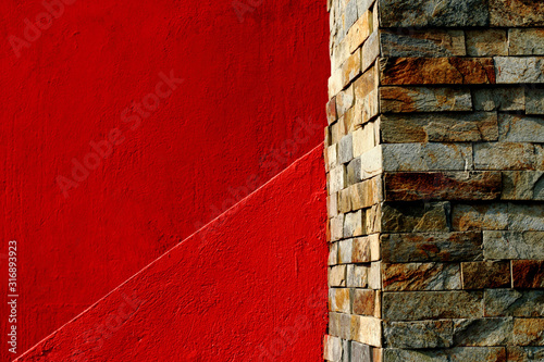 Obraz Abstract minimalist architecture,red wall and stone bricks - fototapety do salonu