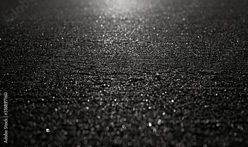 Black shiny rough surface in backlight, angled perspective and selective focus Canvas-taulu