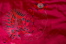 Dragon Embroidery On A Red Sat...
