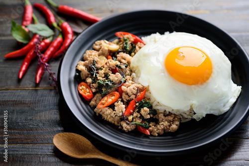 Thai food (Pad Kaprao Moo Kai Dao), stir-fried holy basil with minced pork and f Canvas Print