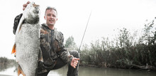 Amateur Angler Stands In The B...