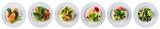set of fresh salads isolated on white