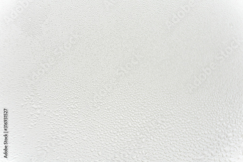 Foto  wet glass texture. light background