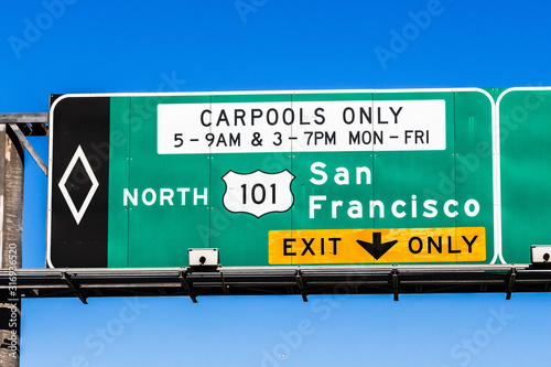 Freeway 101 northbound to San Francisco signage providing directions and the app Wallpaper Mural