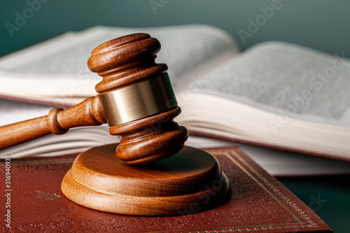 Obraz Close up of a brown wooden gavel and book - fototapety do salonu