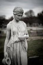 Vertical Shot Of A Statue Of A...