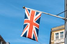 Union Jack UK Flag Waving Against Blue Sky