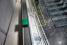 Break Case On Roller Conveyor In Warehouse.