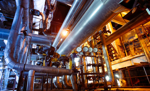 Fototapeta Industrial zone, Steel pipelines, valves and pumps obraz