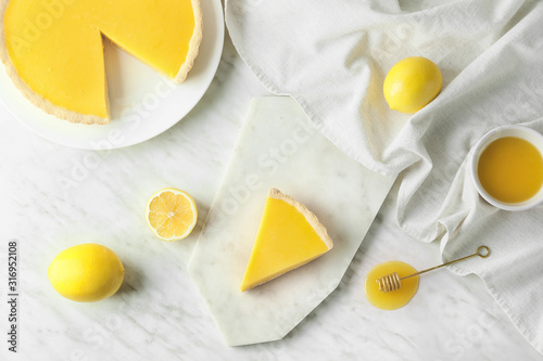 Fototapeta Composition with tasty lemon pie on table obraz