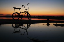 Bike Silhouette In Sunset Sky