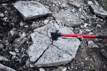Iron Hammer Breaking Stone Into Pieces