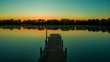 Panoramic shot of a marina during beautiful sunset with silhouetted trees in the distance