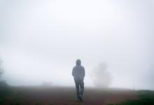 Man Walking Alone On Dark Mist...