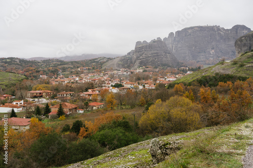 Meteora, Greece - Dec 19, 2019: View of Trikala city in the shadow of the rocks of Meteora Canvas Print