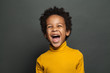 Laughing kid on gray background