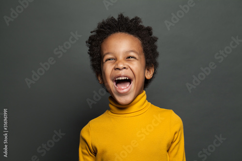 Fotografiet Laughing kid on gray background